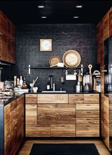 black kitchen with wood