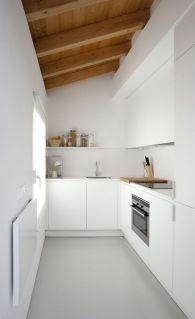 white kitchen with beams